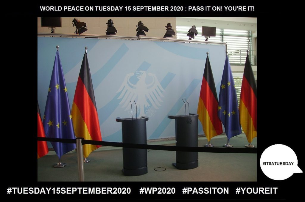 A stage with empty podium and flags of the the European Union and German flag that demonstrates fulfillment of my stand for World Peace through any female leader. In this case in June 2020, Angela Merkel